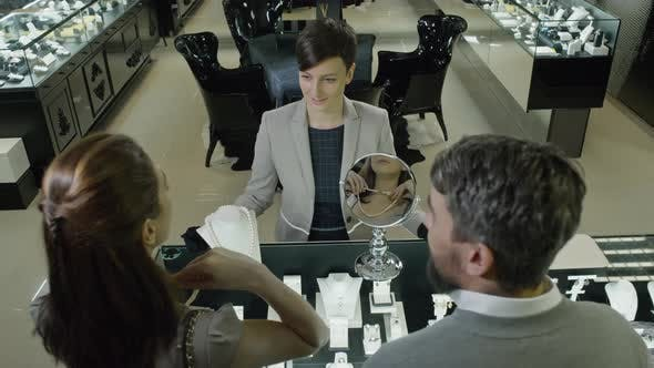Thumbnail for Couple Buying Pearl Necklace in Jewelry Shop
