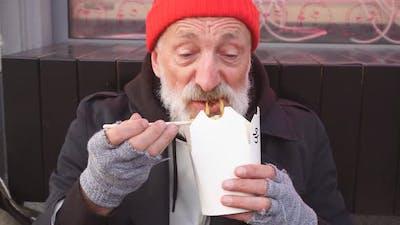 Senior Beggar Man with Grey Beard Eating Food