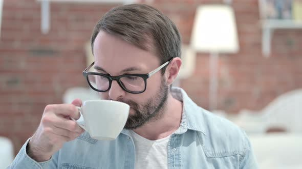 Thumbnail for Portrait of Beard Young Man Having Toothache By Drinking Cold