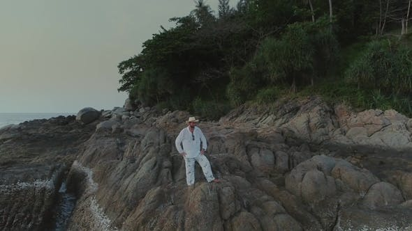 Thumbnail for Man in White on Sunset Beach in Thailand Rocks