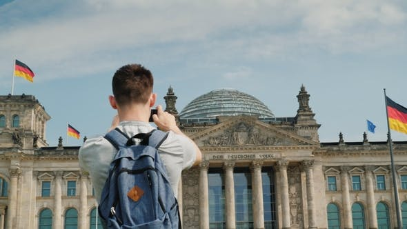 Thumbnail for The Teenager Takes Pictures of the Building of the Bundestag in the Center of Berlin. Tourism in