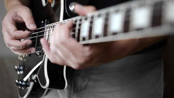 Thumbnail for Musician Soloing on Electric Guitar,plaing on Electric Musical Instruments, Playing Loud on the