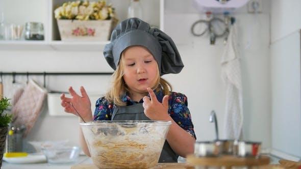 Thumbnail for Preschool Girl Baker Mixes the Dough in a Bowl