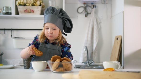 Thumbnail for Preschool Girl Eats Cookies Prepared with Her Own Hands