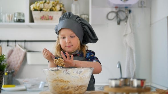 Thumbnail for Little Girl Baker Taste the Cookie Dough