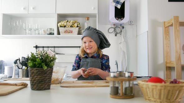 Thumbnail for Little Girl Baker Rolls Out the Dough and Talking