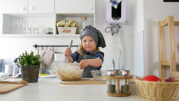 Thumbnail for Girl Baker Mixes the Mixture for Cookies with a Whisk