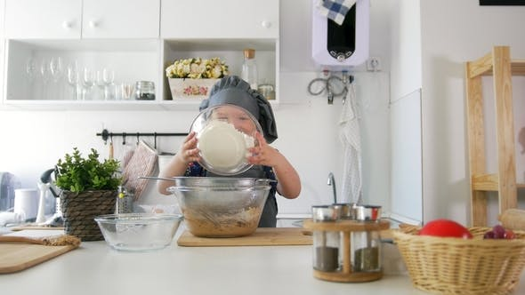 Thumbnail for Preschool Girl Baker Sifts Flour in a Bowl for Cooking Biscuits