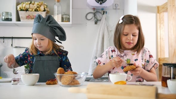Thumbnail for Group of Children Decorating Cookies with Jam