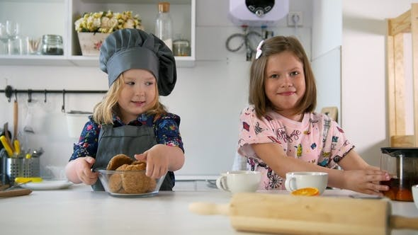 Thumbnail for Two Preschool Girls Bakers Raising Thumbs Up