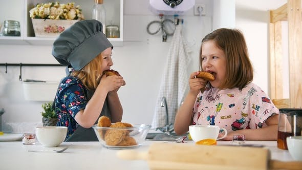 Thumbnail for Two Girls Eats Cookies with Jam Prepared with Their Own Hands