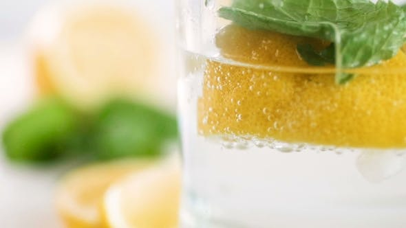 Cover Image for Footage of Floating Air Bubbles in Glass of Cold Lemonade