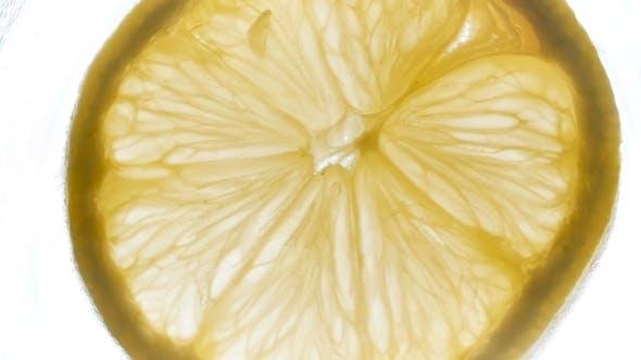 Thumbnail for Footage of Rotating Backlit Lemon Slice