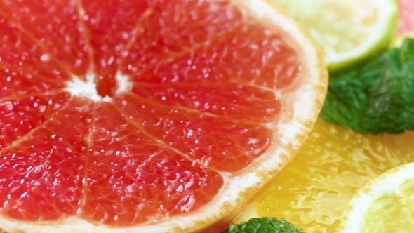 Thumbnail for Footage of Orange, Grapefruit and Lemon Slice Lying on Table