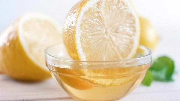 Thumbnail for Footage of Lemon Dipping and Taking out of Glass Honey Jar