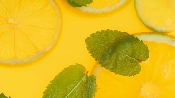 Thumbnail for Video of Fresh Mint Leaves and Orange Slices Floating in Lemonade