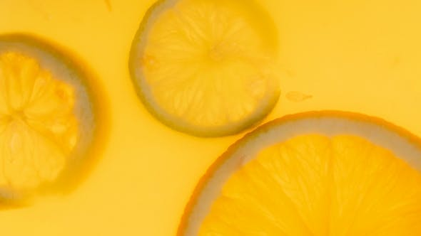 Thumbnail for Footage of Citrus Slices Floating in Fresh Orange Juice