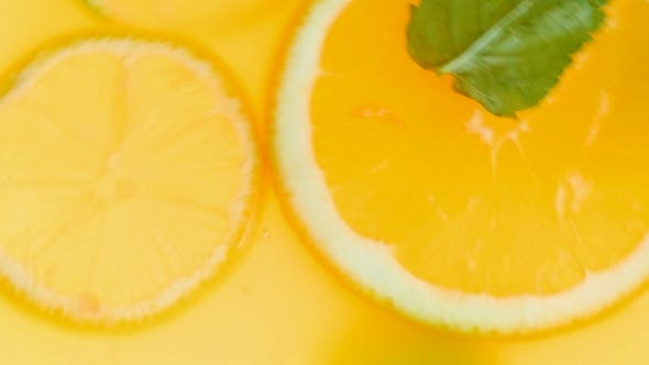 Thumbnail for Video of Mixing and Making Lemonade with Fresh Oranges and Mint Leaves