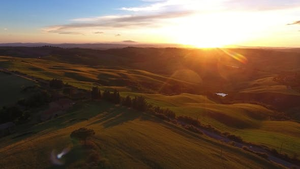 Tuscany Aerial Road and Cypresses at Sunset