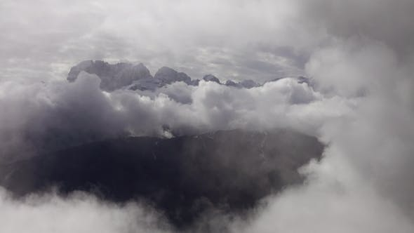 Thumbnail for Mountains in Clouds Landscape in Alps, Italy