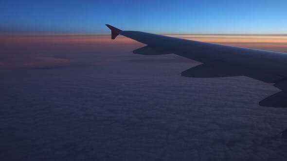 Looking on Wing and Sunset Sky From Airplane