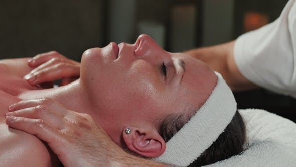 Thumbnail for Hands of Professional Masseuse Massaging Woman's Face in Beauty Saloon