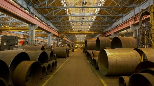 Large Diameter Pipes Stacked in Factory Shop