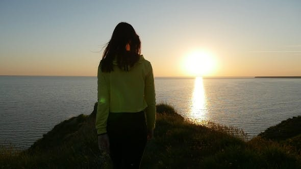 Thumbnail for Stylish Woman Stands on the Black Sea Coast and Looks at the Nice Sunset