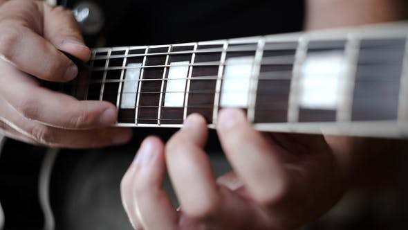 Thumbnail for Musician Uses Tapping Technique To Play the Electric Guitar,playing on Electric Musical Instruments
