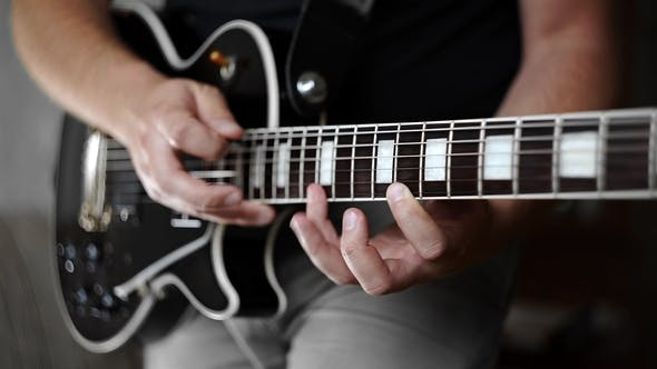 Thumbnail for Musician Plays Solo on the Electric Guitar and Uses Tapping
