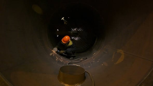 Thumbnail for Worker Cuts Pipeline Using Welding Machine