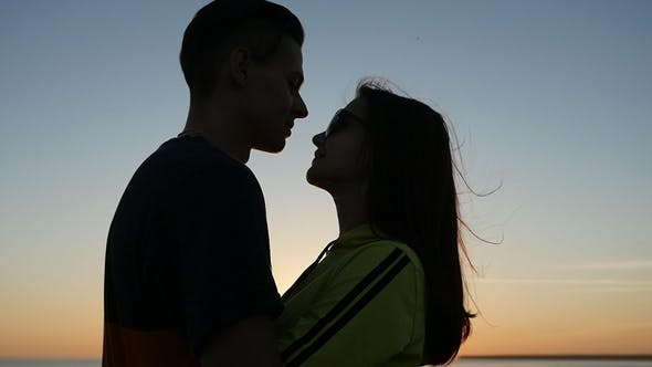 Thumbnail for Romantic Girl and Her Cheery Boy Are at the Black Sea Coast at Sunset in Summer