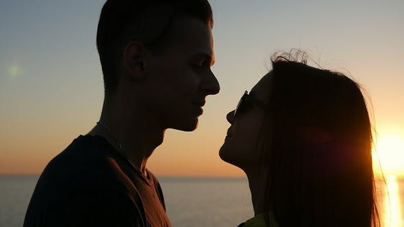 Thumbnail for Smiling Girl and Her Happy Boy Stand on the Black Sea Coast at Sunset in Summer