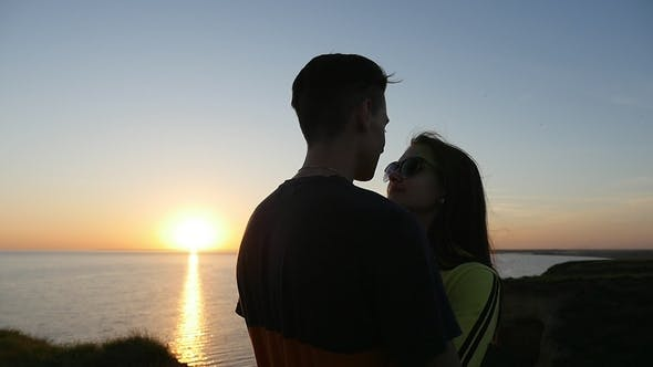 Thumbnail for Lovely Girl and Her Passionate Boyfriend at the Black Sea Coast at Sunset in Summer