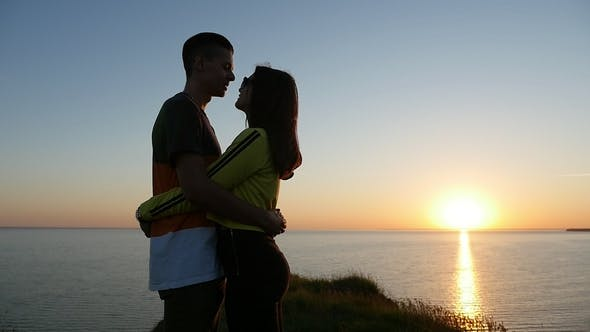 Thumbnail for Amorous Girl and Her Happy Boyfriend at the Black Sea Shore at Sunset in Summer