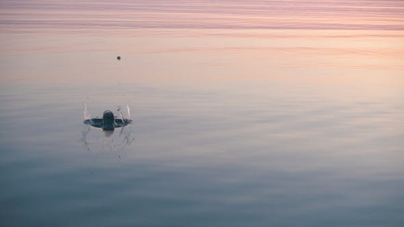 Cover Image for Stone Skipping on Beautiful Calm Water, Majestic Sunrise Around.