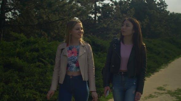 Thumbnail for Cheerful Female Friends Enjoying Walk in Spring Park