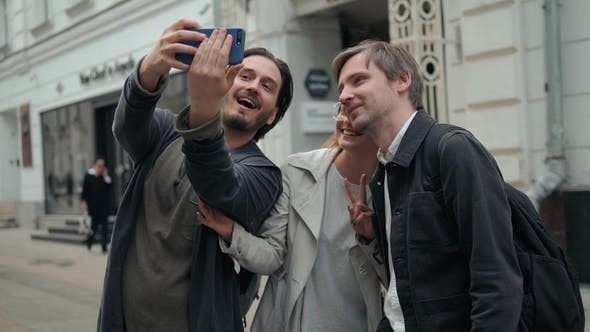 Thumbnail for Portrait of Group of Friends Looking the Camera in the Street Take Selfie. Friendship Concept with