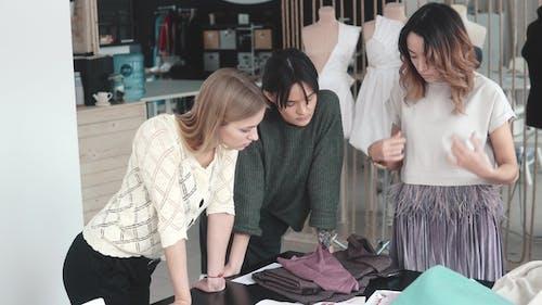 Fashion Designers Work in Their Small Studio