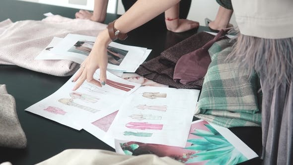Thumbnail for Fashion Designers Choose Fabrics for a New Collection of Clothes. a Group of Designers Works