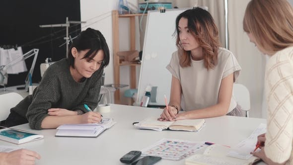 Thumbnail for Seamstresses Discuss Busy Business Planning for Their Small Startup Atelier