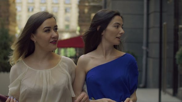 Pretty Shopaholic Women Walking on Shopping Street