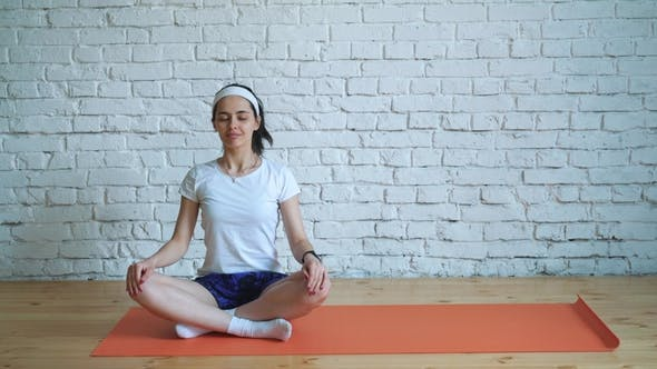 Thumbnail for Girl Does Yoga Exercises in the Gym