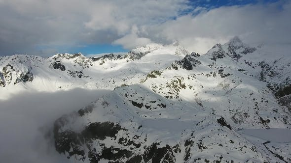 Thumbnail for Snow-capped Mountains in Clouds