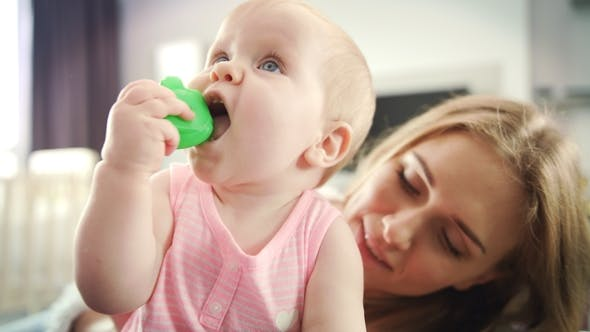 Thumbnail for Mom Kissing Baby. Beautiful Mother Kissing Daughter