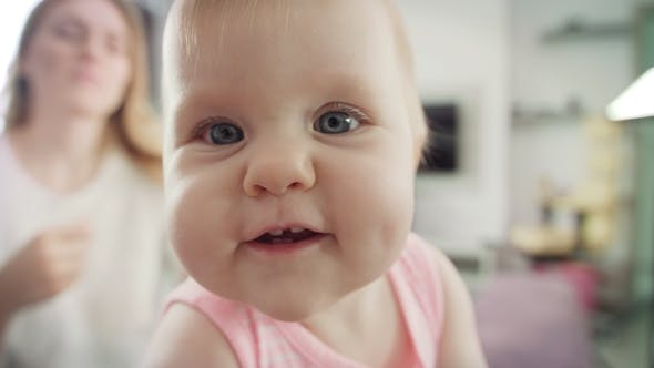 Thumbnail for Adorable Baby Face Portrait of Happy Child Exploring World
