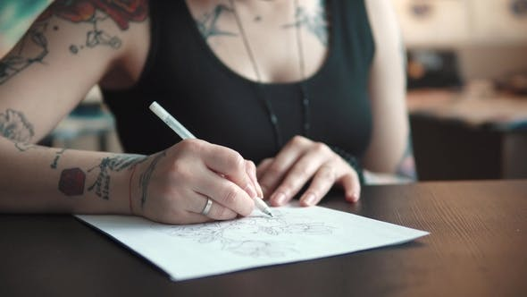 Thumbnail for Tattoo Master Makes a Sketch of Tattoo on Paper