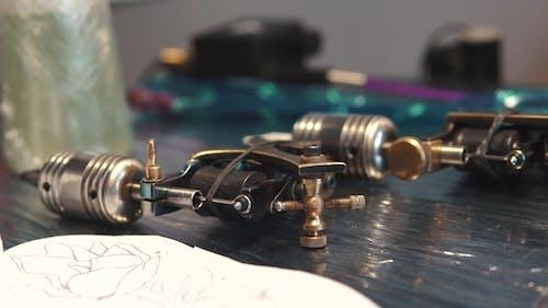 Rotary Tattoo Machine Gun on the Table