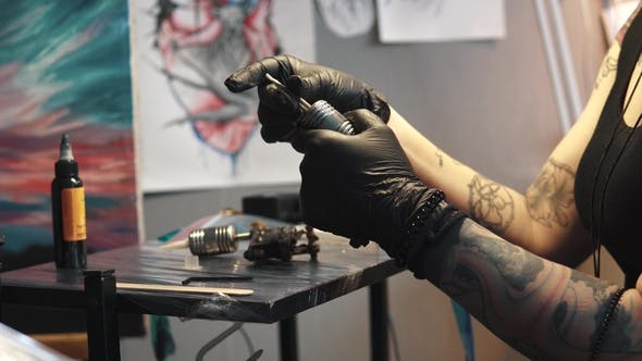 Thumbnail for Tattoo Artist Collects the Tattoo Machine. Girl Tattoo Master Prepares a Rotary Tattoo Machine Gun