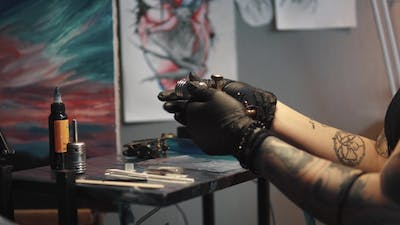 Tattoo Artist Collects the Tattoo Machine. Girl Tattoo Master Prepares a Rotary Tattoo Machine Gun